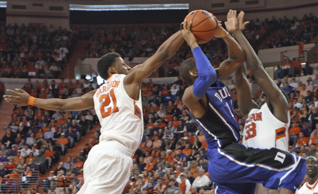 Duke's Jabari Parker, center, attempts a shot between Clemson's Demarcus Harrison, left, and Josh Smith during an NCAA college basketball game Saturday, Jan. 11, 2014, in Clemson, S.C. (AP Photo/Anderson Independent-Mail, Mark Crammer)