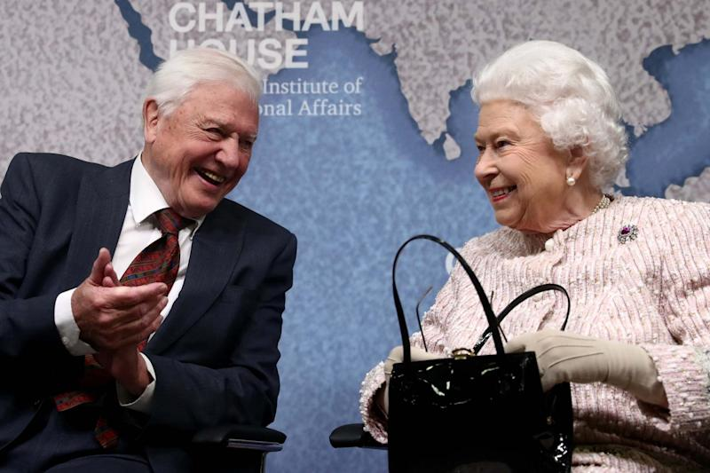 David Attenborough sits next to Queen Elizabeth during the annual Chatham House award in London (REUTERS)
