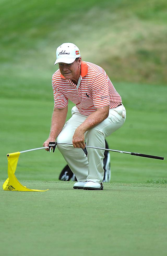 Tom Watson lines up his putt during the first round of the Greenbrier Classic golf tournament at the Greenbrier Resort in White Sulphur Springs, W.Va., Thursday July 3, 2014 (AP Photo/Chris Tilley)