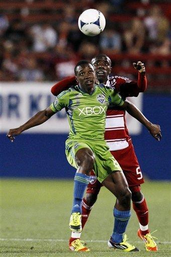 Seattle Sounders' Cordell Cato fights off FC Dallas' Jair Benitez, rear, as Cato attempts to control the ball in the second half of an MLS soccer match, Wednesday, May 9, 2012, in Frisco, Texas. The Sounders won 2-0. (AP Photo/Tony Gutierrez