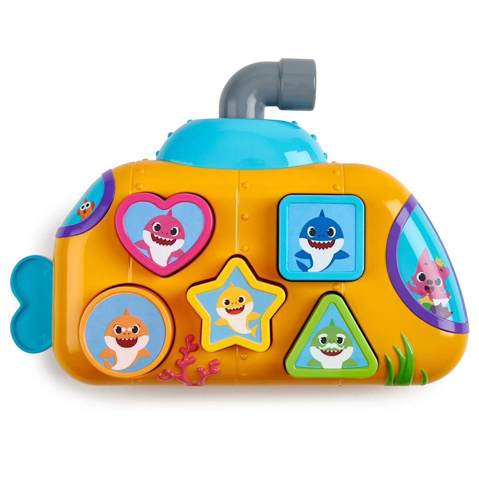 """<p>This <a href=""""https://www.popsugar.com/buy/Baby-Shark-Melody-Shape-Shorter-511967?p_name=Baby%20Shark%20Melody%20Shape%20Shorter&retailer=amazon.com&pid=511967&price=20&evar1=moms%3Aus&evar9=45808433&evar98=https%3A%2F%2Fwww.popsugar.com%2Fphoto-gallery%2F45808433%2Fimage%2F45808438%2FPinkfong-Baby-Shark-Melody-Shape-Shorter&list1=toy%20fair%2Ckid%20shopping&prop13=api&pdata=1"""" rel=""""nofollow"""" data-shoppable-link=""""1"""" target=""""_blank"""" class=""""ga-track"""" data-ga-category=""""Related"""" data-ga-label=""""http://www.amazon.com/WowWee-Pinkfong-Shark-Melody-Sorter/dp/B07NJPKDM3"""" data-ga-action=""""In-Line Links"""">Baby Shark Melody Shape Shorter</a> ($20) teaches little ones 18 months and older the ins and outs of shapes while they listen to the iconic tune. Oh, and did we mention it lights up? So stinkin' cute.</p>"""