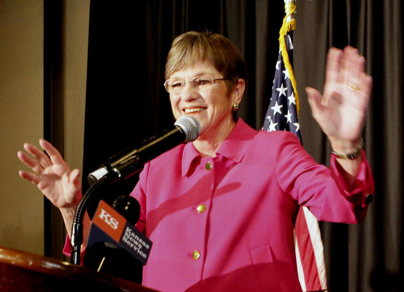 Democrat Laura Kelly talks to the crowd at the Ramada Hotel and Convention Center in Topeka, Kans., after she defeated Republican Kris Kobach Tuesday night to become the next Kansas governor. (Thad Allton/The Topeka Capital-Journal via AP)
