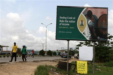 A billboard campaign against crude oil theft is seen alongside a road in Yenagoa, the capital of Nigeria's oil state of Bayelsa