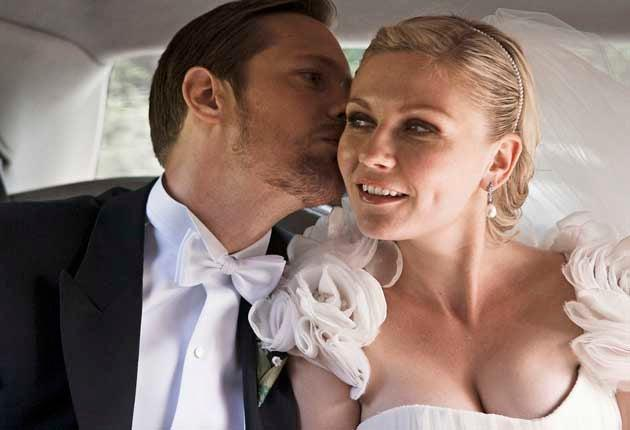 Whisper It: Kirsten Dunst plays a bride-to-be alongside Alexander Skarsgard in MelancholiaChristian Geisnaes