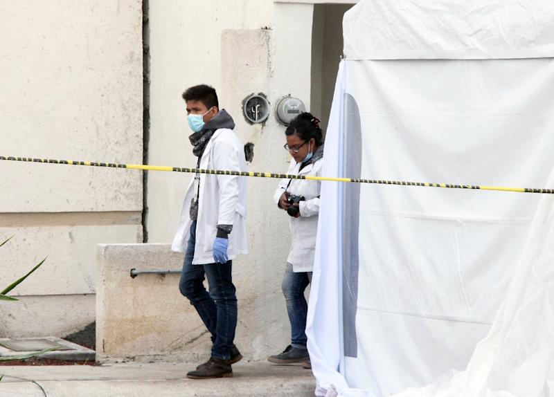 Forensic personnel work on a crime scene where attackers burst into a party and killed 11 people in Tizayuca, Mexico