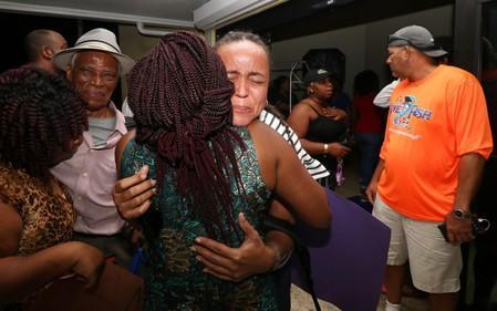 Families react as they are reunited after a church group was evacuated from the Abaco Islands after Hurricane Dorian made landfall in Nassau