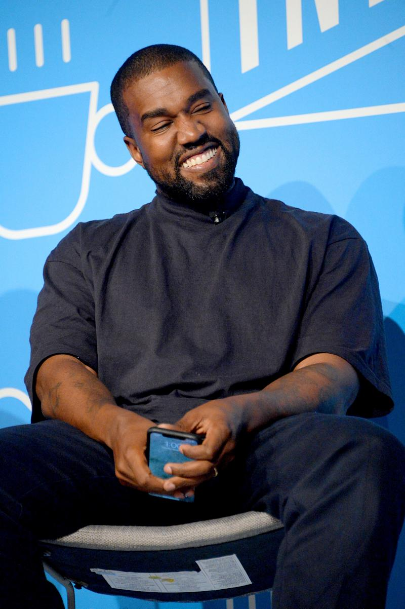 Kanye West looks adorable in casual T-shirt and denim pant, with a cute smile on his face