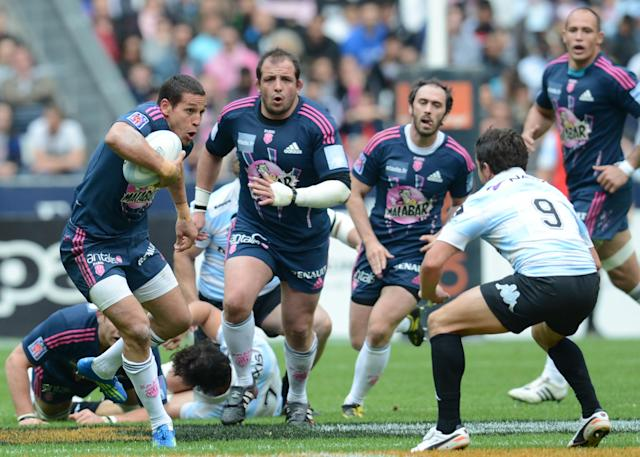 Stade Francais' French winger Julien Arias (L) runs with the ball despite of Racing Metro's French fly-half Sebastien Descons (R) during the French Top 14 rugby union match Stade Francais vs. Racing Metro on May 5, 2012 at the Stade de France stadium in Saint-Denis. AFP PHOTO / FRANCK FIFEFRANCK FIFE/AFP/GettyImages