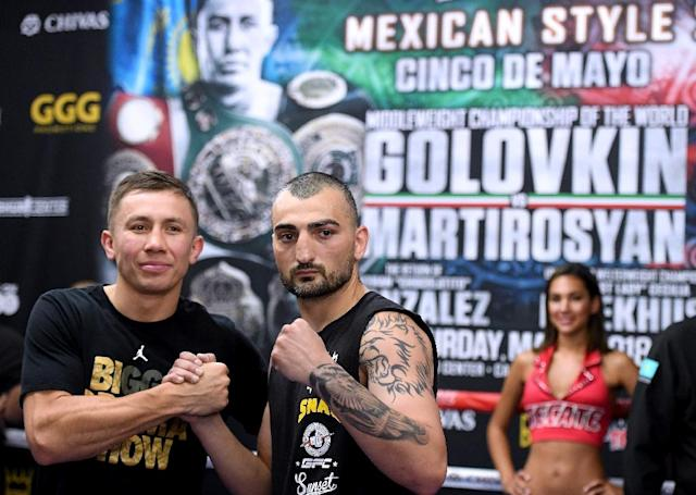Vanes Martirosyan (R) and Gennady Golovkin pose during a media workout at the Glendale Fighting Club on April 23, 2018. (AFP Photo)