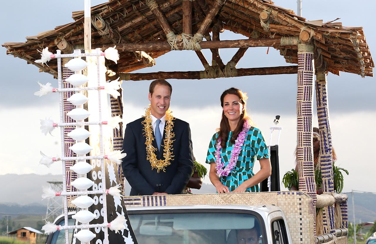 HONIARA, GUADALCANAL ISLAND, SOLOMON ISLANDS - SEPTEMBER 16:  Prince William, Duke of Cambridge and Catherine, Duchess of Cambridge travel in a special boat vehicle as they arrive at Honiara International Airport during their Diamond Jubilee tour of the Far East on September 16, 2012 in Honiara, Guadalcanal Island. Prince William, Duke of Cambridge and Catherine, Duchess of Cambridge are on a Diamond Jubilee tour representing the Queen taking in Singapore, Malaysia, the Solomon Islands and Tuvalu.  (Photo by Chris Jackson/Getty Images)