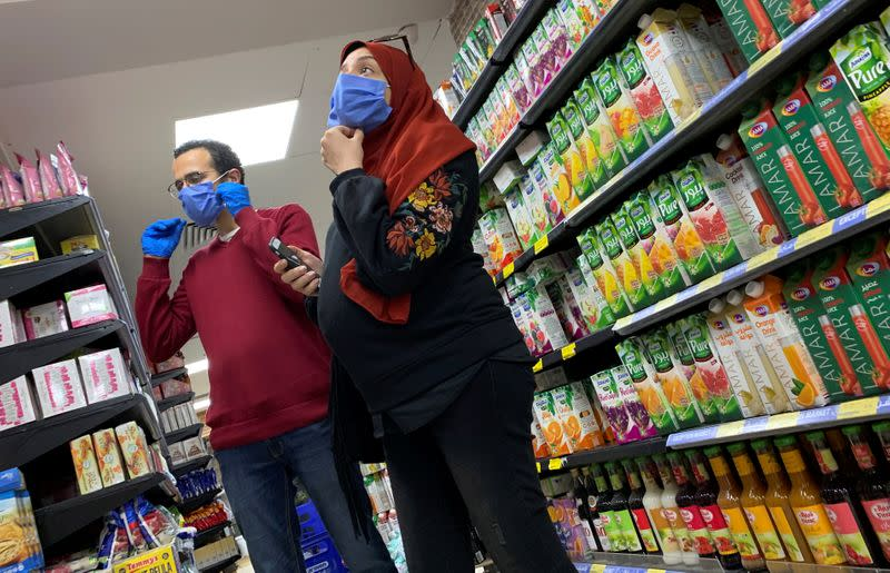 A family with protective masks is seen at a market in Cairo