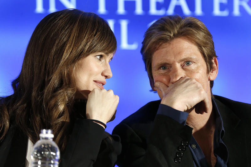 """Actors Jennifer Garner and Denis Leary talk during an appearance at a news conference for the movie """"Draft Day"""" in New York on Friday, Jan. 31, 2014. (AP Photo/Paul Sancya)"""