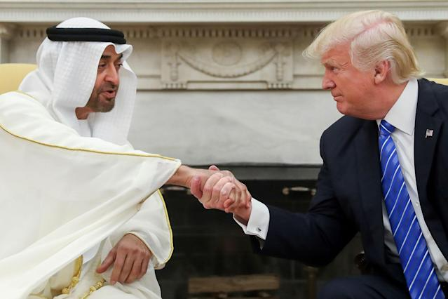 <p>President Donald Trump shakes hands with Abu Dhabi's Crown Prince Sheikh Mohammed bin Zayed Al Nahyan, Monday, May 15, 2017, in the Oval Office of the White House in Washington. (Photo: Andrew Harnik/AP) </p>