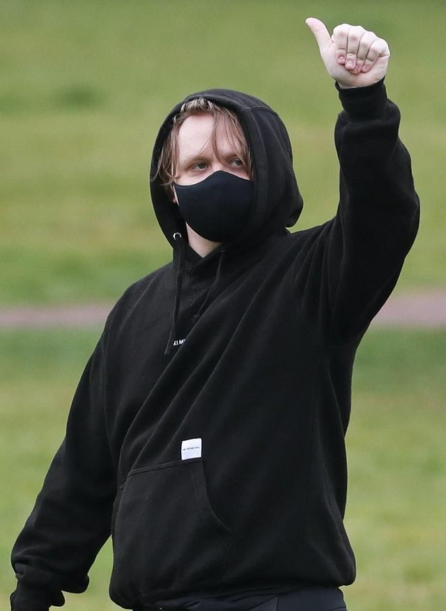 Singer Lewis Capaldi joined a protest rally in Holyrood Park, Edinburgh