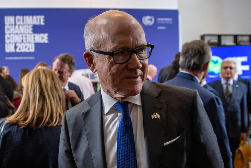 FILE PHOTO: U.S. Ambassador to the United Kingdom, Woody Johnson, is pictured after listening British Prime Minister Boris Johnson and David Attenborough during a conference about the UK-hosted COP26 UN Climate Summit, at the Science Museum in London