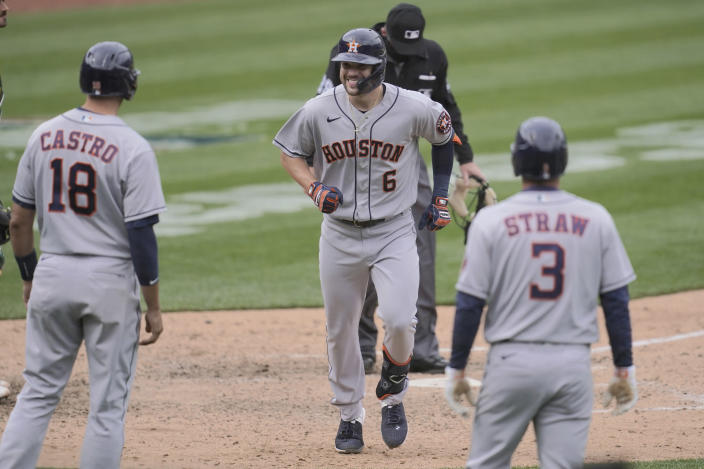 Houston Astros' Chas McCormick (6) smiles after hitting a three-run home run that scored Jason Castro (18) and Myles Straw (3) against the Oakland Athletics during the sixth inning of a baseball game in Oakland, Calif., Sunday, April 4, 2021. (AP Photo/Jeff Chiu)
