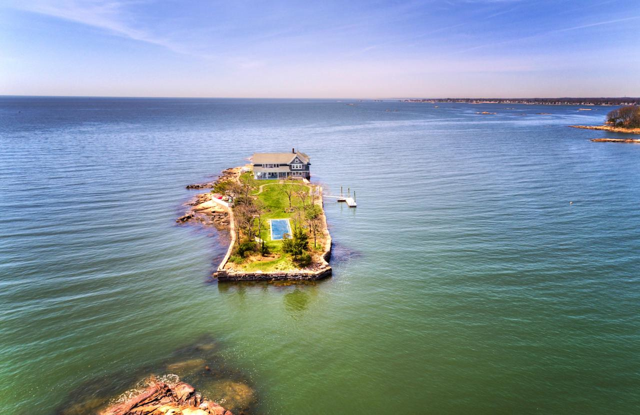 """<a href=""""https://www.christiesrealestate.com/sales/detail/170-l-78183-1805101311556549/0-potato-island-branford-ct-06405"""">Location: Potato Island, Branford, Connecticut</a><br> Price:$4,900,000<br> Bed/Baths:4 bedrooms; 3 full and 1 partial bathrooms<br> Interior Square Footage:3,871<br> Lot Size: 1.1 acres"""