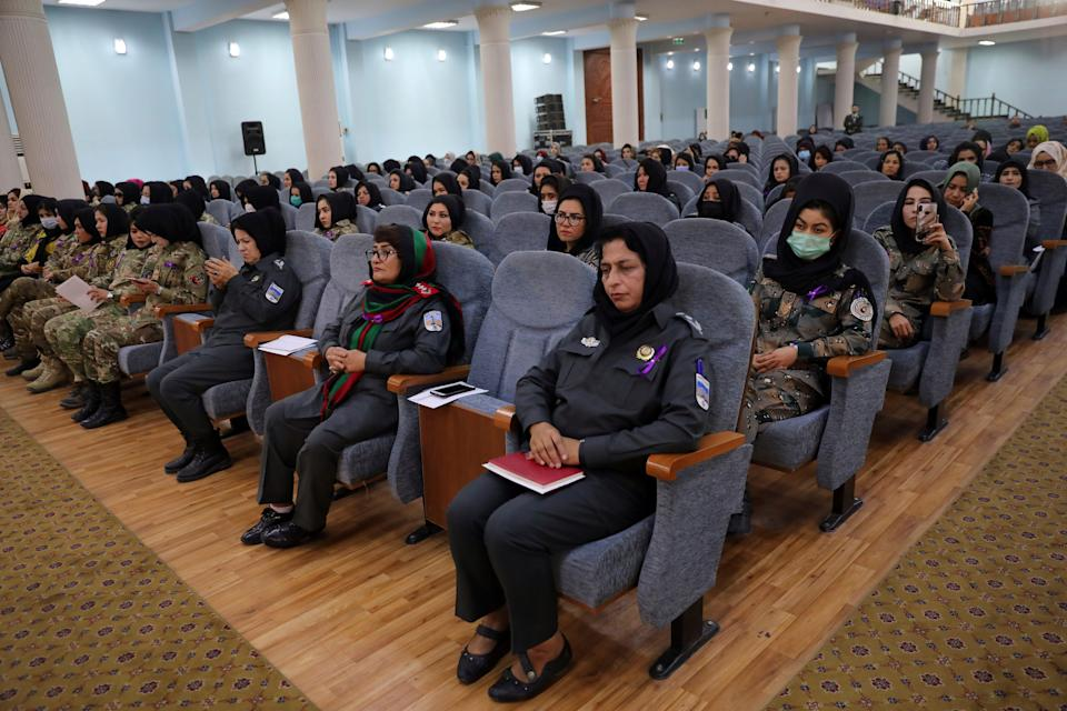 Afghan women police officers attend an event to mark International Women's Day in Kabul, Afghanistan, Sunday, March 7, 2021.