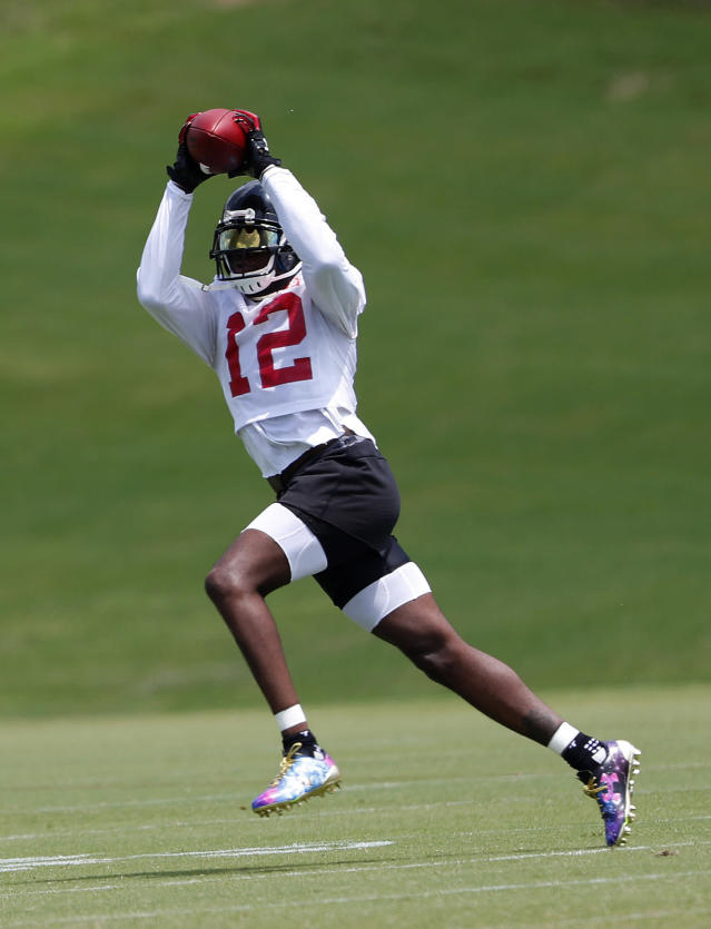 Atlanta Falcons wide receiver Mohamed Sanu (12) makes a catch during NFL football minicamp Wednesday, June 13, 2018 in Flowery Branch, Ga. (AP Photo/John Bazemore)