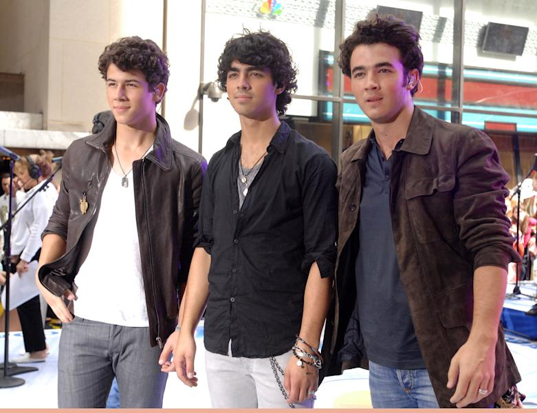 "FILE - This June 19, 2009 file photo shows musicians, from left, Nick Jonas, Joe Jonas, and Kevin Jonas of the music group The Jonas Brothers on the NBC ""Today"" television program in New York. The band announced Tuesday, Oct. 19, 2013, they're ending their highly successful run. The news comes after the brothers abruptly canceled their tour over creative differences earlier this month. (AP Photo/Peter Kramer, File)"
