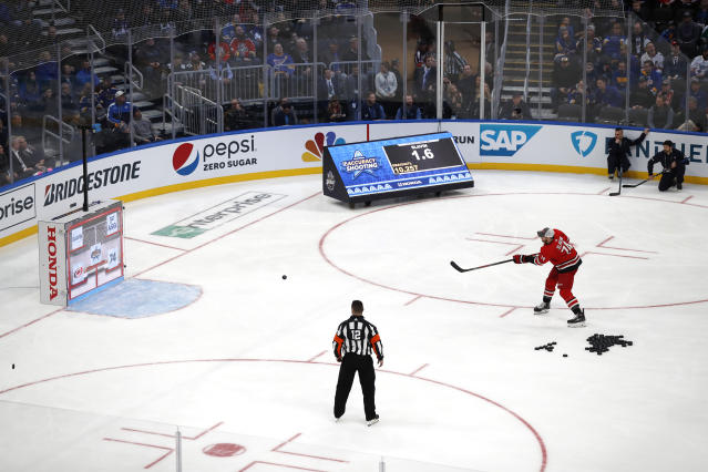 Carolina Hurricanes' Jaccob Slavin shoots during the Skills Competition accuracy shooting event, part of the NHL All-Star weekend, Friday, Jan. 24, 2020, in St. Louis. Slavin won the event. (AP Photo/Jeff Roberson)