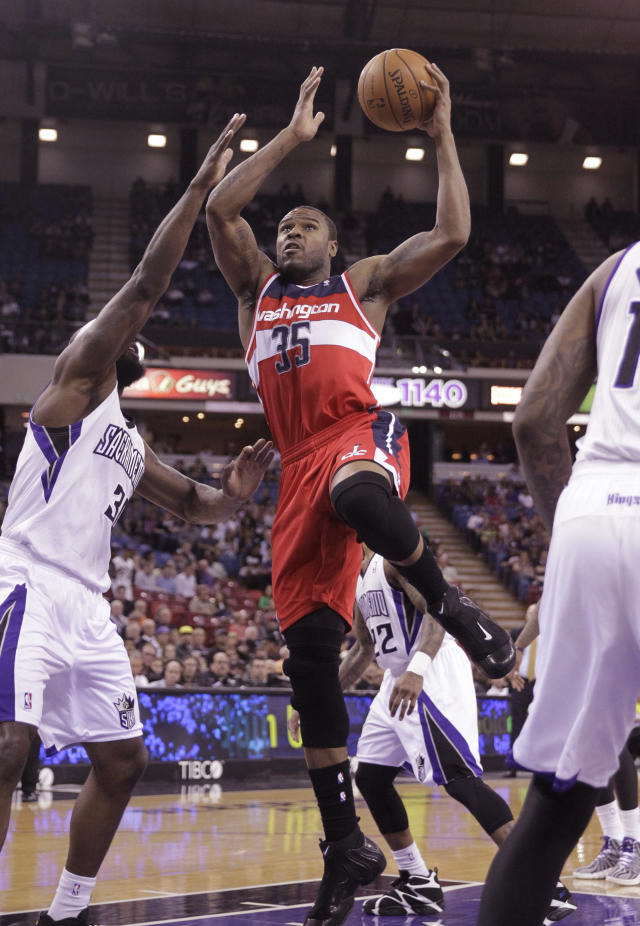 Washington Wizards forward Trevor Booker, right, drives to the basket against Sacramento Kings forward Reggie Evans, left, during the first quarter of an NBA basketball game in Sacramento, Calif., Tuesday, March 18, 2014.(AP Photo/Rich Pedroncelli)