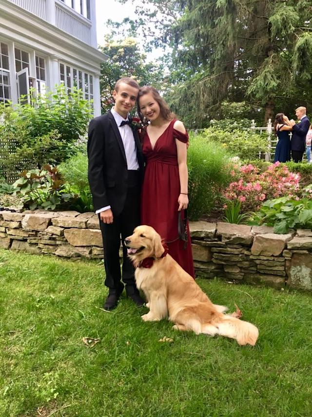 Claire and her boyfriend pose for prom pictures. (Photo: Facebook/Percie the Service Dog)