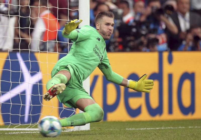 Liverpool's goalkeeper Adrian stops a penalty shot from Chelsea's Tammy Abraham during the UEFA Super Cup soccer match between Liverpool and Chelsea, in Besiktas Park, Thursday, Aug. 15, 2019. (AP Photo)