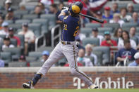 Milwaukee Brewers left fielder Christian Yelich (22) strikes out during the first inning of Game 4 of a baseball National League Division Series against the Atlanta Braves, Tuesday, Oct. 12, 2021, in Atlanta. (AP Photo/Brynn Anderson)