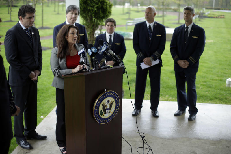 Rep. Mike Fitzpatrick, R-Pa., left, and airline pilots look on as Ellen Saracini, at podium, whose husband Victor was the captain of United Airlines Flight 175 that crashed into the World Trade Center on Sept. 11, 2001, speaks during a news conference at the at the Garden of Reflection memorial to local victims of the 9/11 terrorist attacks, Monday, April 29, 2013, in Yardley, Pa. Fitzpatrick proposed new legislation aimed at protecting airline passengers and pilots from the kind of terrorist attack upon the nation a dozen years ago. (AP Photo/Matt Rourke)