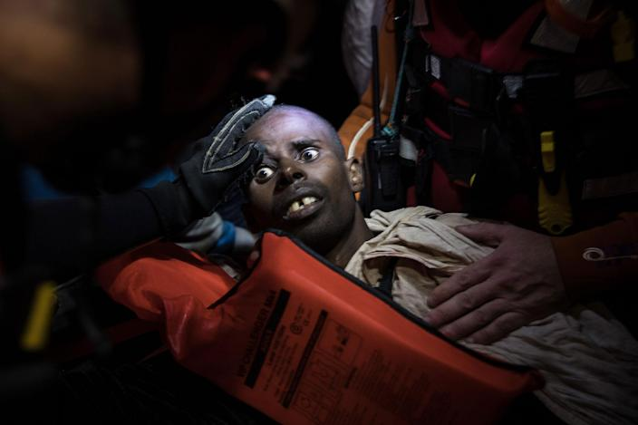 <p>NOV. 22, 2016 — Members of MOAS (Migrant Offshore Aid Station) and the Red Cross try to keep a man alive, who it was believed was suffering after breathing fumes from a boat engine he was travelling on on November 21, 2016 in Pozzollo Italy. The MOAS team worked through the night and into the next morning rescuing 'approximately' 600 people from vessels. MOAS are currently patrolling international waters off the coast of Libya, and running rescue missions for the many migrants and refugees who continue to attempt to make the dangerous crossing across the Mediterranean Sea to Italy. MOAS are a Malta based registered foundation dedicated to providing professional search-and-rescue assistance to refugees and migrants in distress at sea and work alongside with the Red Cross on board the Topaz Responder. The number of deaths this year of people crossing the Mediterranean has risen to almost 4,300. MOAS alone have rescued around 19,000. (Photo by Dan Kitwood/Getty Images) </p>