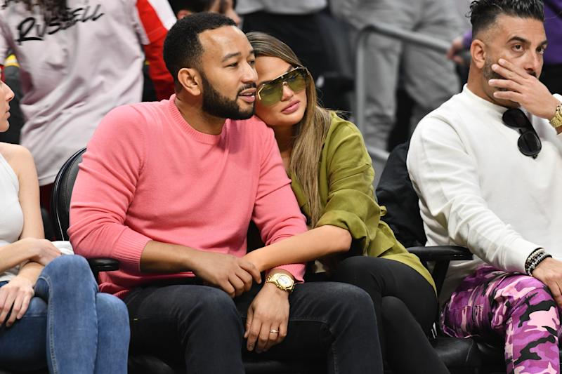 John Legend and Chrissy Teigen attend a basketball game between the Los Angeles Clippers and the Los Angeles Lakers at Staples Center on March 08, 2020 in Los Angeles, California. (Photo by Allen Berezovsky/Getty Images)