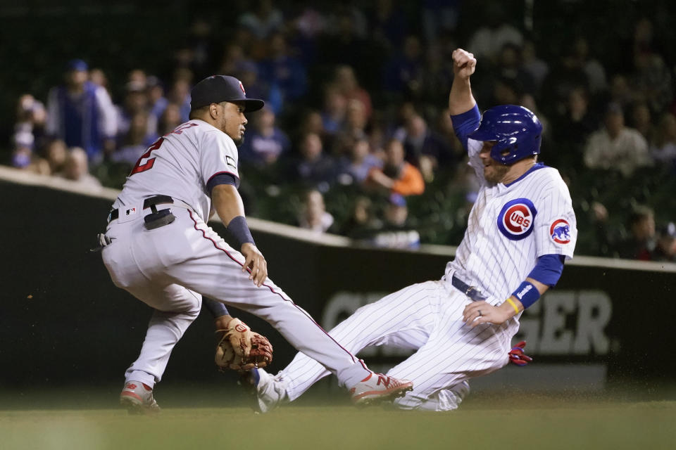 Chicago Cubs' Patrick Wisdom, right, steals second as Minnesota Twins' Luis Arraez waits for the throw from catcher Mitch Garver during the third inning of a baseball game Tuesday, Sept. 21, 2021, in Chicago. (AP Photo/Charles Rex Arbogast)