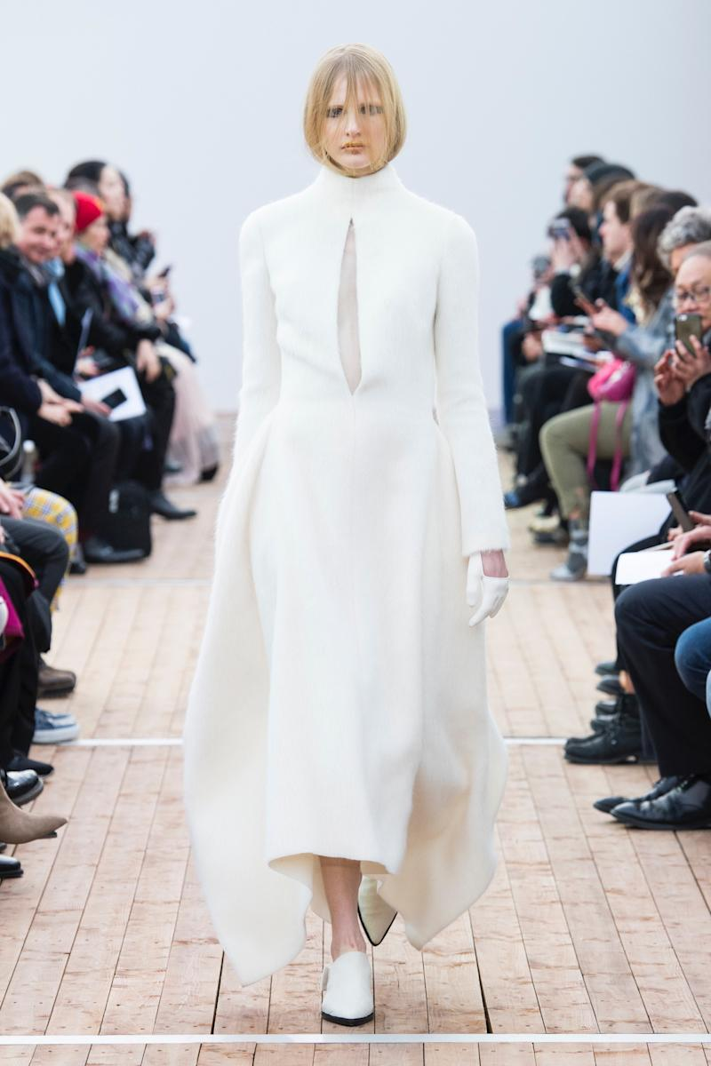 Image result for Guy Laroche Richard René married the radical with the minimalist, as seen in this high-neck, handkerchief-hem dress with a sheer-paneled keyhole cut down to there.