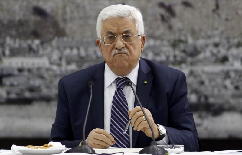 Palestinian President Mahmoud Abbas attends a meeting with Palestinian leaders in the West Bank city of Ramallah in this April 1, 2014 file picture. Israel suspended peace talks with the Palestinians on April 24, 2014 in response to Abbas's unity agreement with Hamas Islamists. REUTERS/ Mohamad Torokman/Files (WEST BANK - Tags: POLITICS)