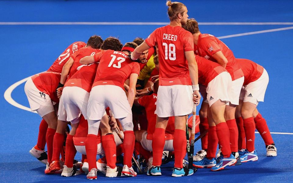 Great Britain huddle up before the start of the match - REUTERS