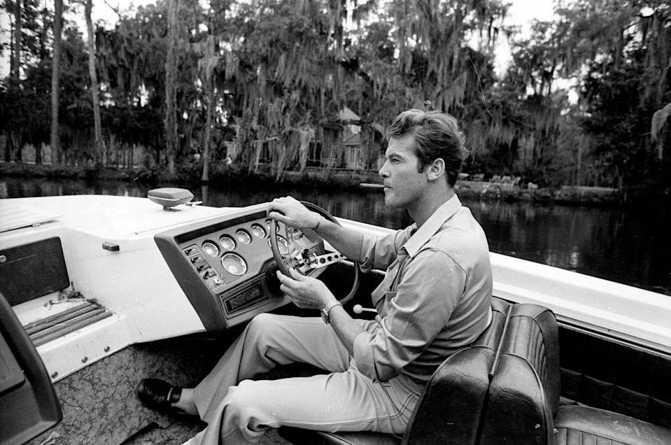 <p>Roger Moore takes a break during filming 'Live and Let Die', 1973. </p>