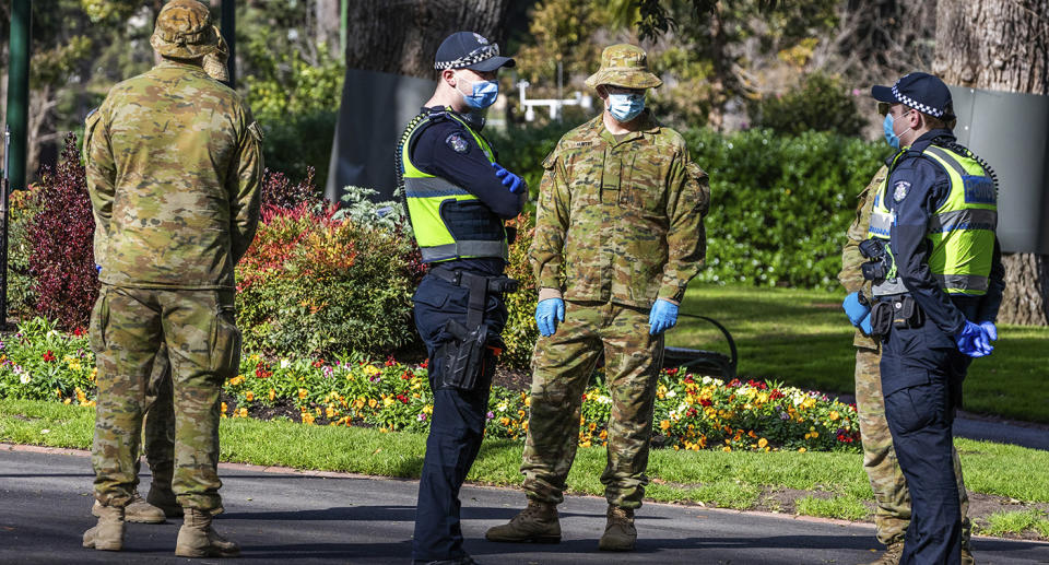 Australian Defence Force staff assisted Victorian police during Melbourne's lockdown last year. Source: AP