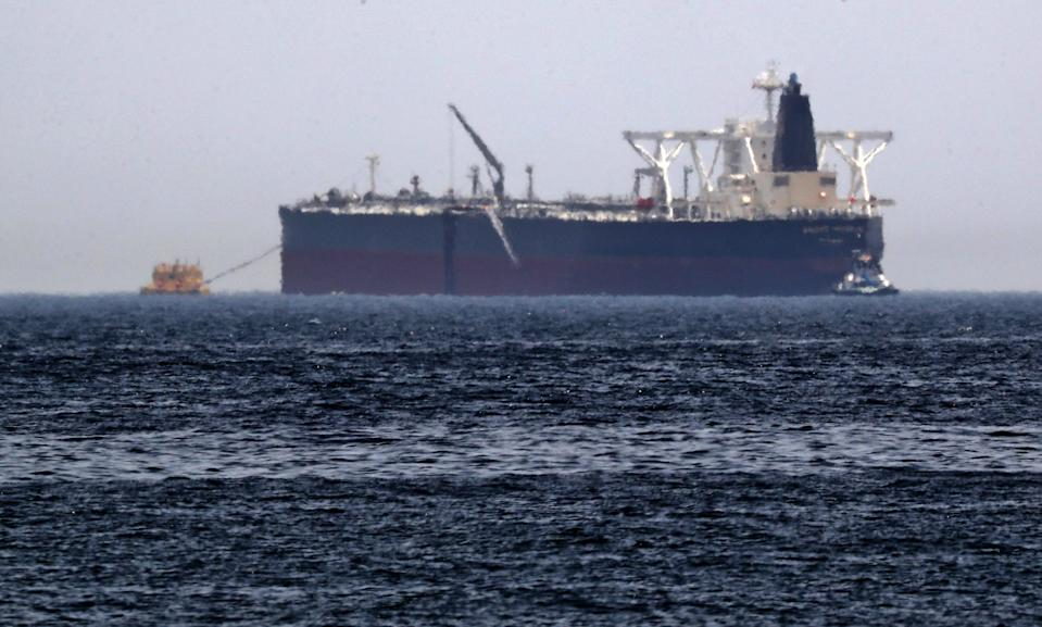 """A picture taken on May 13, 2019, shows the crude oil tanker, Amjad, which was one of two Saudi reported tankers that were damaged  in mysterious """"sabotage attacks"""", off the coast of the Gulf emirate of Fujairah. - Saudi Arabia said two of its oil tankers were damaged in mysterious """"sabotage attacks"""" in the Gulf as tensions soared in a region already shaken by a standoff between the United States and Iran. (Photo by KARIM SAHIB / AFP)        (Photo credit should read KARIM SAHIB/AFP/Getty Images)"""