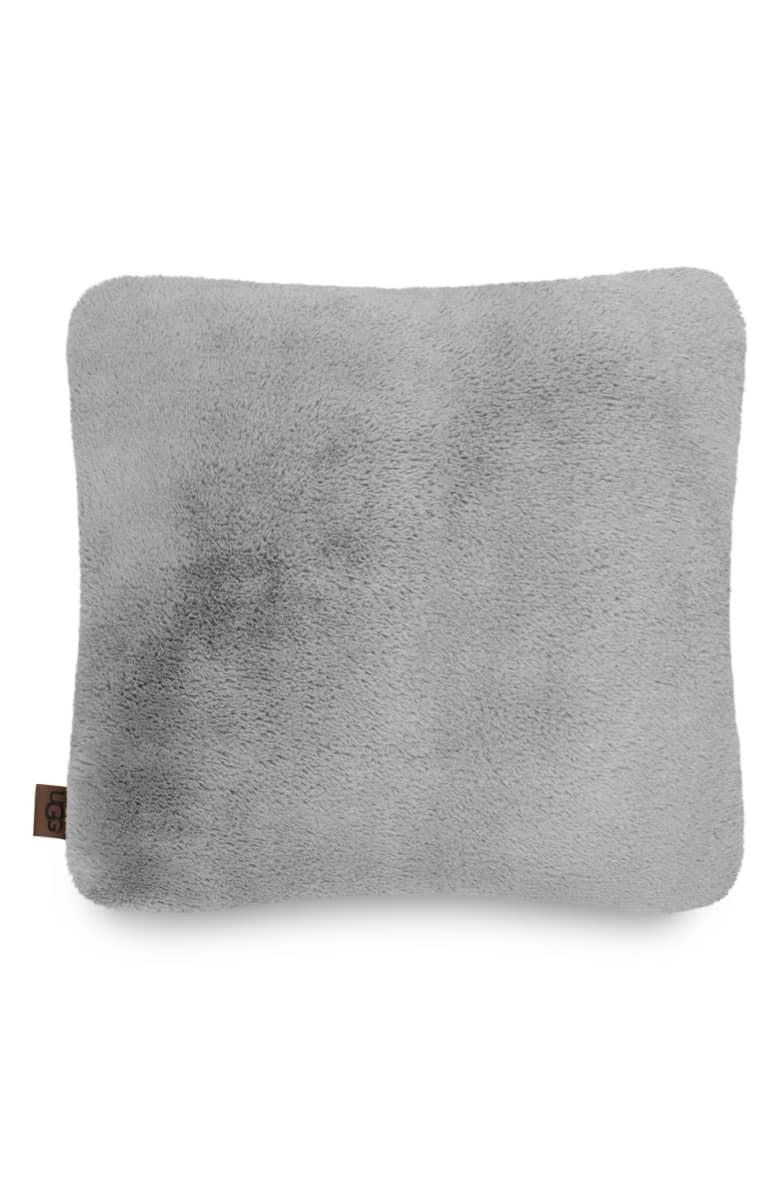<p>You'll want to nap on this <span>UGG Coastline Faux Fur Pillow</span> ($54) all the time.</p>