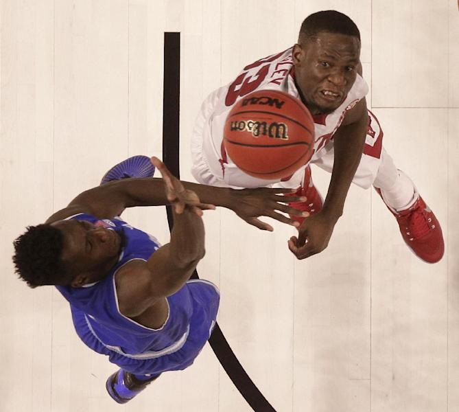 Seton Hall's Myles Powell, left, shoots over Arkansas's Moses Kingsley, right, during the second half in a first-round game of the NCAA men's college basketball tournament in Greenville, S.C., Friday, March 17, 2017. (AP Photo/Rainier Ehrhardt)