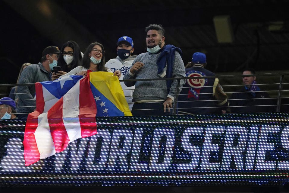 Fans watch during batting practice before Game 3 of the baseball World Series between the Los Angeles Dodgers and the Tampa Bay Rays Friday, Oct. 23, 2020, in Arlington, Texas. Ray beat the Dodgers 6-4.(AP Photo/Eric Gay)