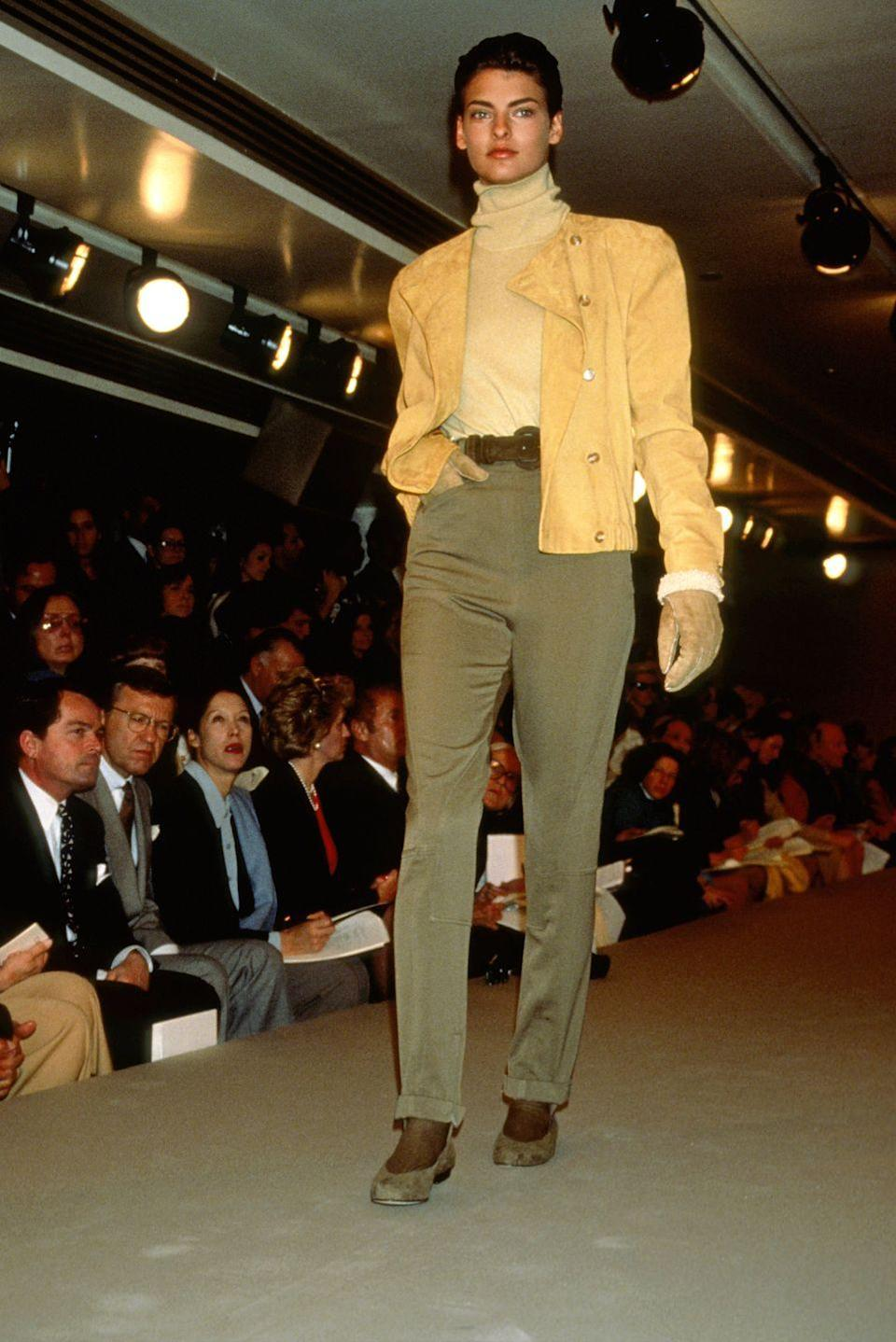 <p>Linda Evangelista wears a suede jacket, a turtleneck, and trousers at the Calvin Klein fashion show. </p>