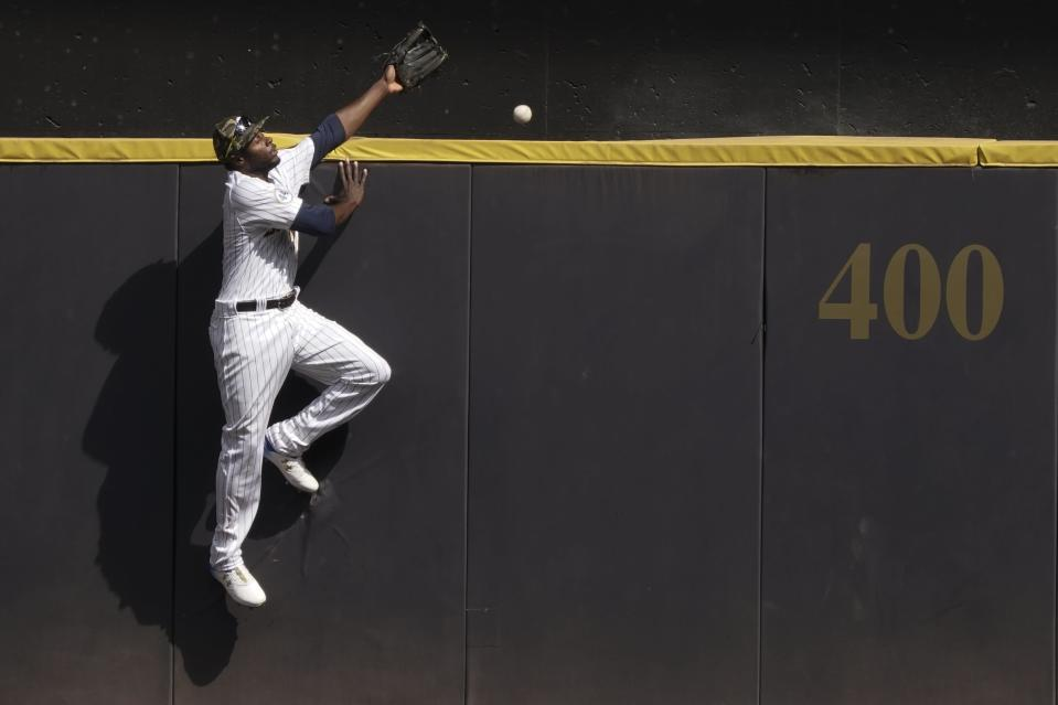 Milwaukee Brewers' Lorenzo Cain can't catch a grand slam hit by Atlanta Braves' Freddie Freeman during the seventh inning of a baseball game Sunday, May 16, 2021, in Milwaukee. (AP Photo/Morry Gash)
