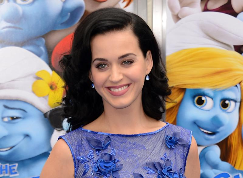 """FILE - This July 28, 2013 file photo shows singer Katy Perry at the world premiere of """"The Smurfs 2"""" in Los Angeles. Perry says though she's """"older and wiser,"""" she still plans to have fun on her new album. Perry debuted 12 songs from """"Prism"""" in front of an audience of 100 industry insiders and journalists Thursday, Sept. 5, in New York. (Photo by Jordan Strauss/Invision/AP, File)"""