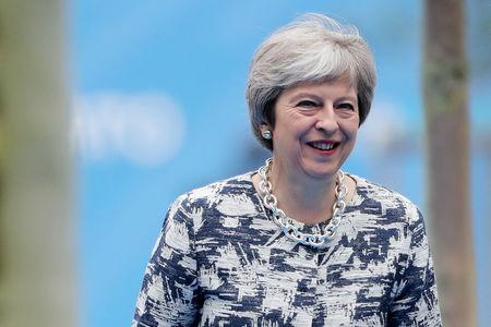 FILE PHOTO: Britain's Prime Minister Theresa May arrives for the second day of a NATO summit in Brussels, Belgium, July 12, 2018. Tatyana Zenkovich/Pool via REUTERS/File Photo
