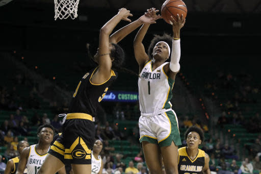 Baylor forward NaLyssa Smith (1) goes up for a rebound over Grambling State center Kailyn Gideon (33) in the second half of an NCAA college basketball game in Waco, Texas, Friday, Nov. 8, 2019. (AP Photo/Tony Gutierrez)