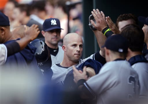 New York Yankees' Brett Gardner, center, gets high-fives in the dugout after he scored on a single by Travis Hafner during the first inning of a baseball game against the Baltimore Orioles, Tuesday, May 21, 2013, in Baltimore. (AP Photo/Nick Wass)