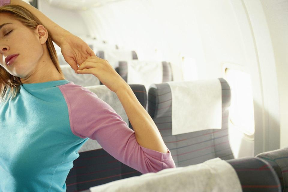 """""""Getting up and stretching during long flights can contribute greatly to reducing chronic pain,"""" says Dr. Jordan Talley, the chief medical advisor at Spero CBD."""