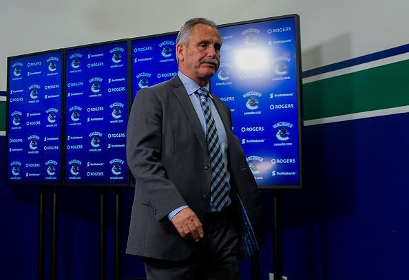 """<a class=""""link rapid-noclick-resp"""" href=""""/nhl/teams/van/"""" data-ylk=""""slk:Vancouver Canucks"""">Vancouver Canucks</a> Head Coach Willie Desjardins leaves the post game press conference after addressing the media in NHL action on April 8, 2017 at Rogers Arena in Vancouver, British Columbia, Canada. (Getty Images)"""